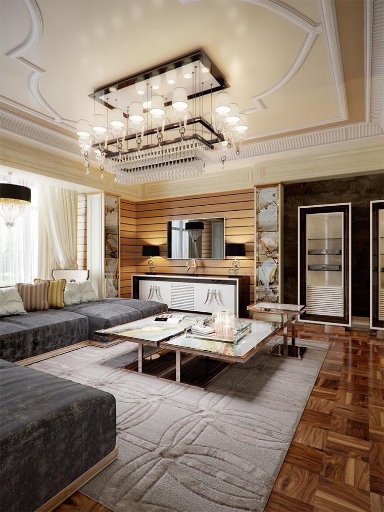 Sala da pranzo e salotto insieme, divano di colore grigio, tappeto pelo corto, pavimento in legno