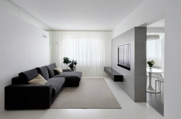 Living con parete divisoria, divano angolare, soggiorno con pareti bianche