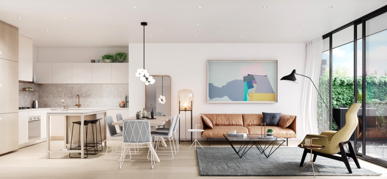 open space con un divano vintage in pelle, poltrona e lampada a pianta, cucina con isola