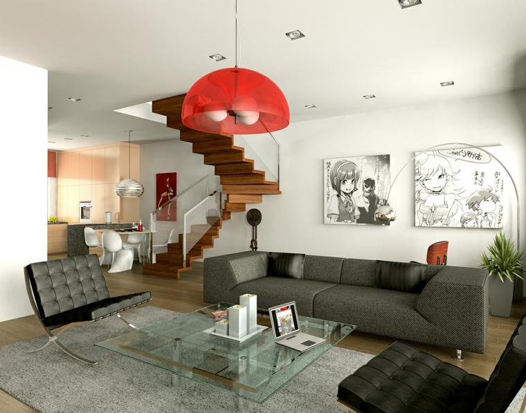 open space con divano grigio e poltrone nere di design, parquet e scala in legno