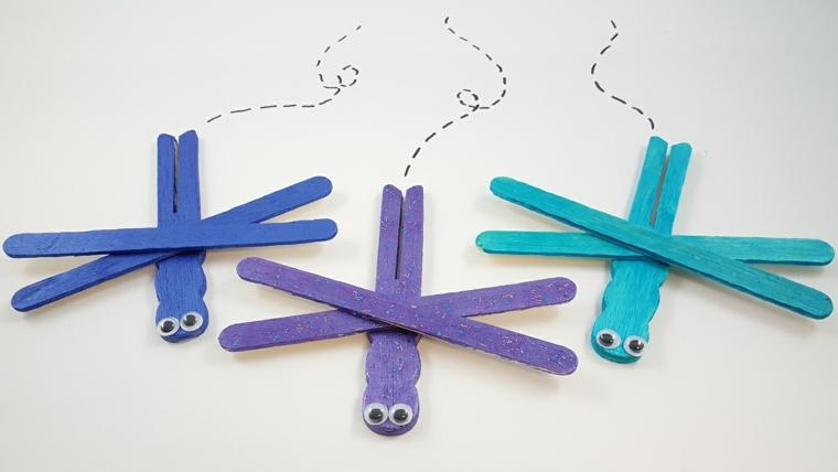 bastoncini di legno colorati trasformati in libellule, idea fai da te per la festa della mamma