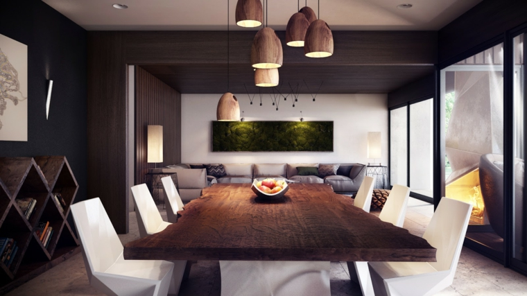 open space rettangolare con soluzioni di design: tavolo in legno e sedie bianche, pareti scure e libreria a terra