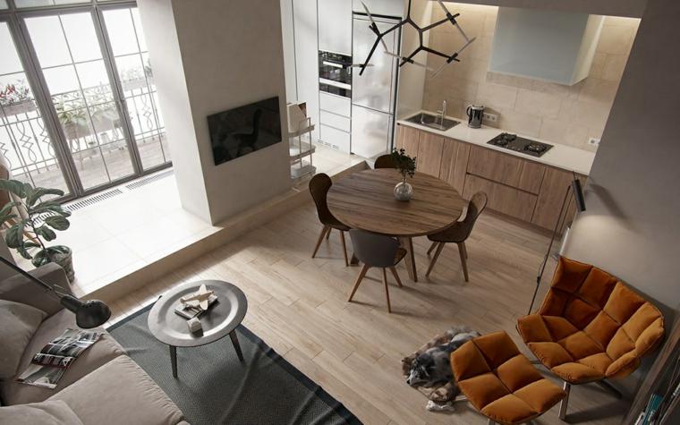 Soggiorno a due livelli, tavolo da pranzo rotondo, arredare piccoli spazi, poltrona colore senape