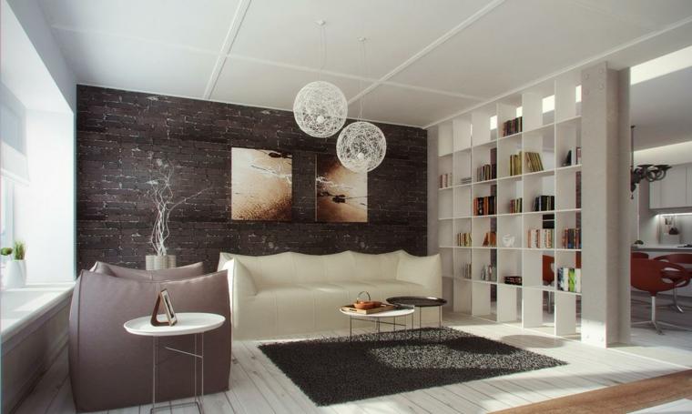 stanza arredata con mobili moderni e di design con una libreria bianca come divisorio