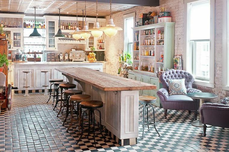 ottima proposta per allestire cucine stile shabby chic con un mobile bar e sgabelli al centro, poltrone e mensole a vista