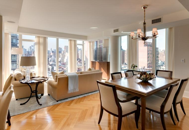 esempio d'arredo per salotti moderni con tavolo quadrato per il pranzo, divano e poltrone color crema, ampie e luminose vetrate
