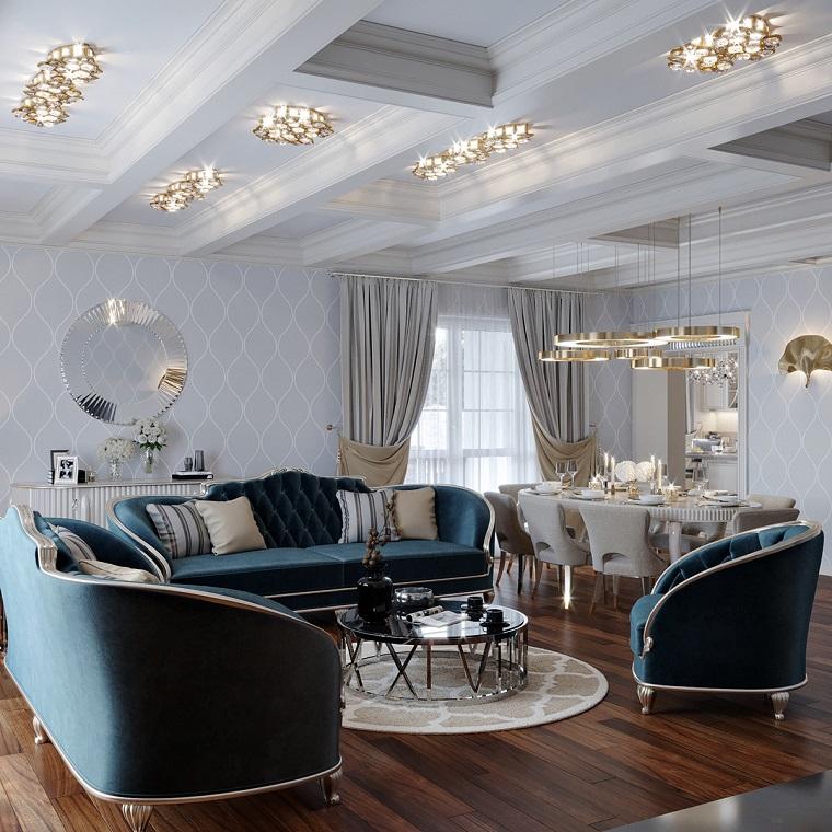 Arredare cucina soggiorno ambiente unico, divano di colore blu, soffitto con luci