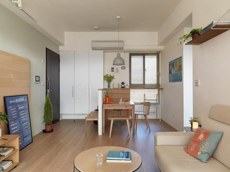 Arredare cucina soggiorno ambiente unico, tavolo da pranzo quadrato, divano beige di pelle