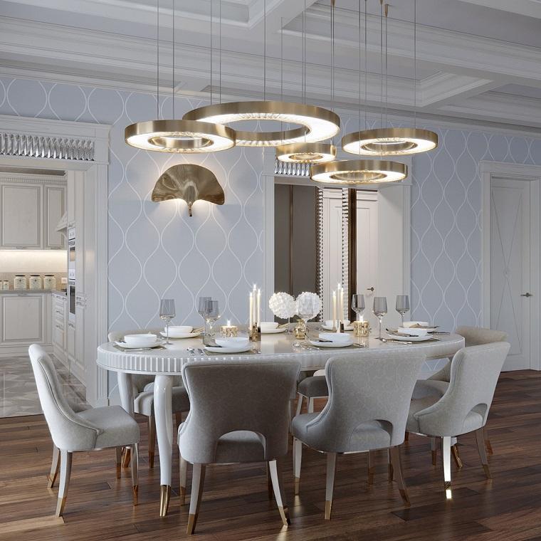 Come arredare un soggiorno rettangolare, tavolo da pranzo, lampadari ad anelli sospesi