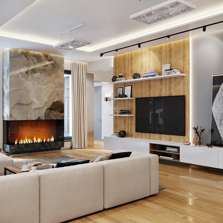 Come arredare un soggiorno rettangolare, divano di colore bianco, camino sulla parete