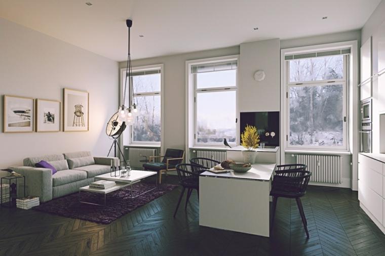 Arredare cucina soggiorno ambiente unico, divano con tavolino, parete con quadri