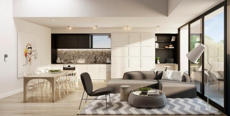 Arredare salotto e sala da pranzo insieme, cucina di colore bianco, tappeto con print geometrici