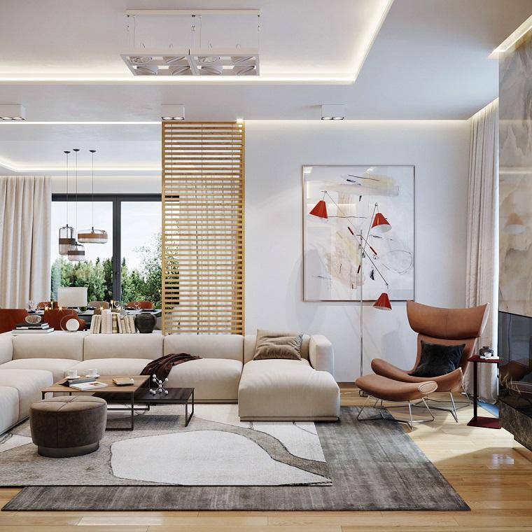 Arredare piccoli spazi, soggiorno don divano, parete scorrevole di legno