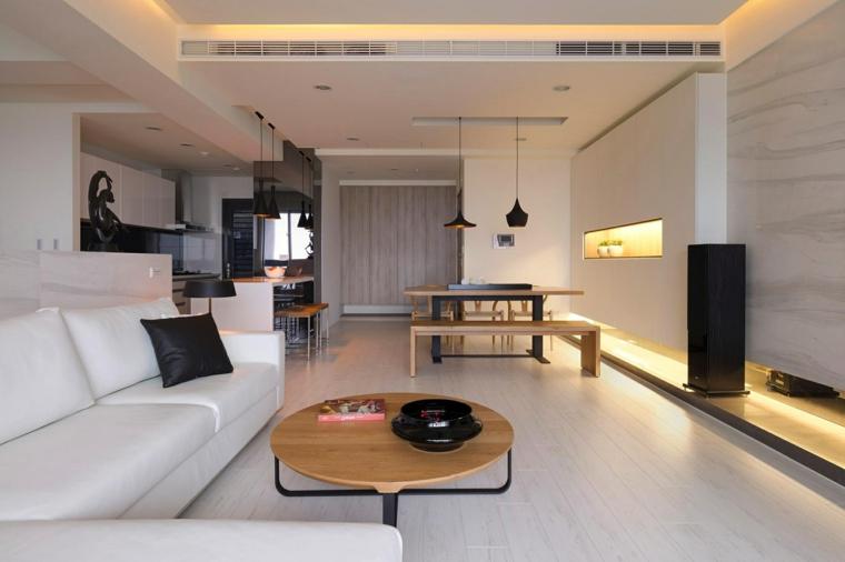 proposta per come arredare un soggiorno rettangolare con divano angolare bianco e zona da pranzo di design