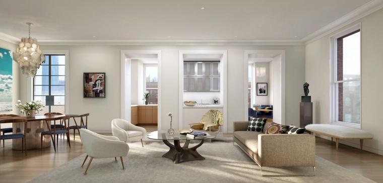pareti bianche e pavimento in parquet per un soggiorno con tavolo da pranzo open space ampio e moderno