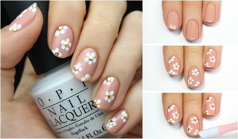Nails art con fiorellini bianchi, unghie da sposa, smalto base rosa di OPI, manicure forma arrotonda di media lunghezza
