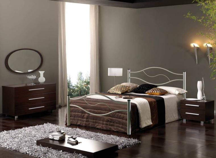 elegante camera da letto color tortora con struttura letto in acciaio, comodino e mobile in legno