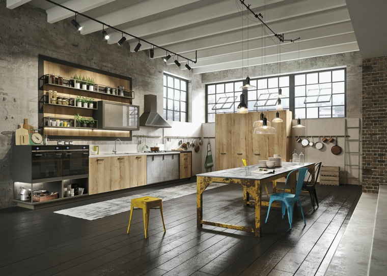 stile industriale, cucina open space con pareti in pietra, mobili in legno e tavolo in ferro giallo con sgabelli