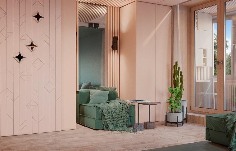 Arredamento soggiorno moderno design con un piccolo divano verde e decorazione con piante da appartamento