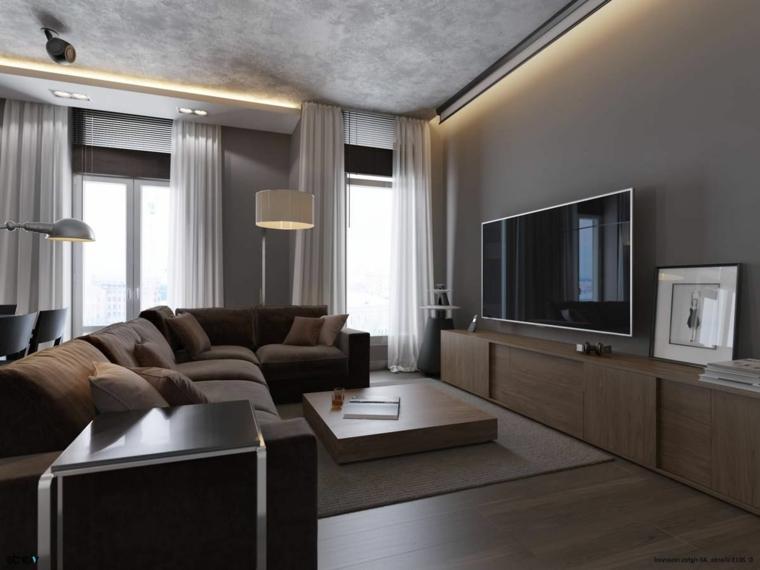 zona living con mobili moderni, un divano ad angolo e muri color tortora, grandi finestre con tende bianche