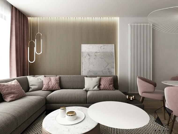 Abbinamento colori pareti con un'illuminazione nascosta, divano grigio con cuscini colorati e tavolini