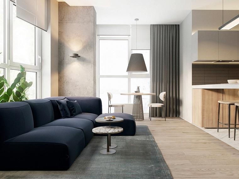 Idea per arredare salotto e sala da pranzo insieme, grande divano di colore blu e tavolini