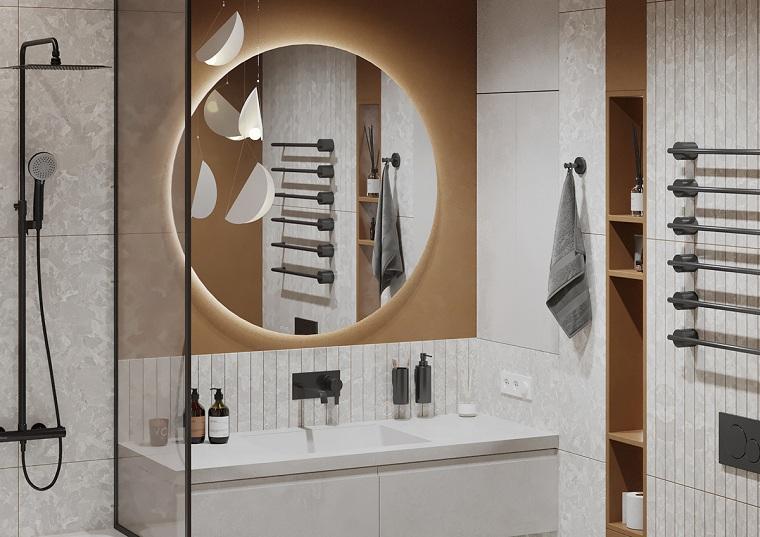 Rivestimenti bagni esempi, lavabo da incasso e uno specchio con retro illuminazione