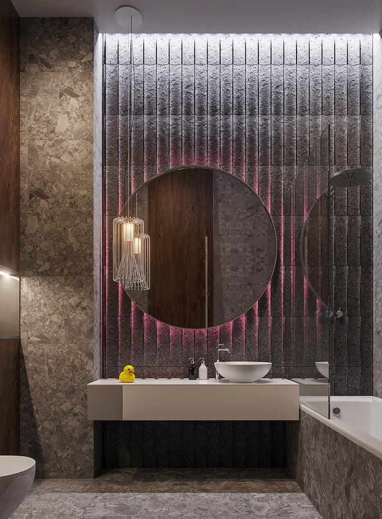 Come arredare un bagno, sala da bagno con vasca separata con vetro, lavandino con specchio rotondo