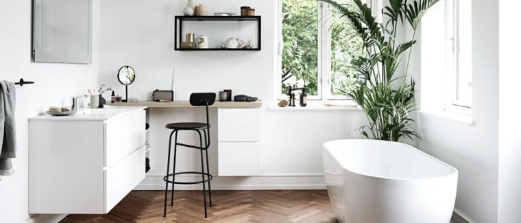 Come arredare un bagno, mobile lavabo e zona trucco con mensola nera, vasca dalla forma ovale