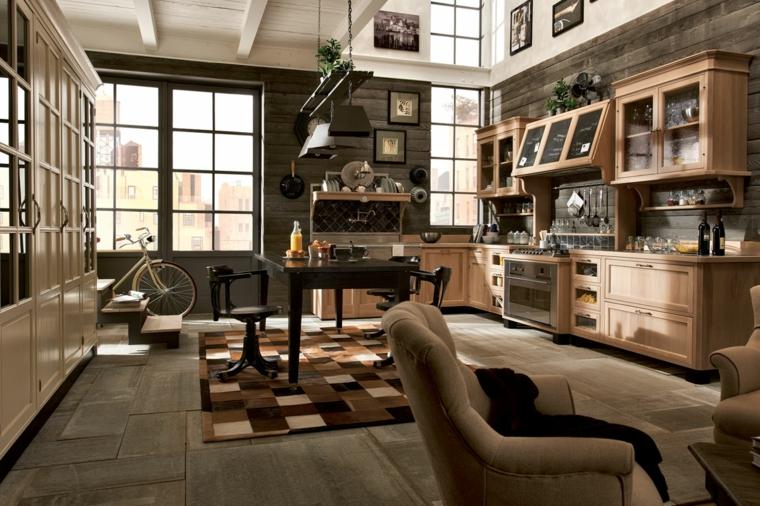 loft dallo stile industriale con mobili della cucina in legno e pareti in pietra