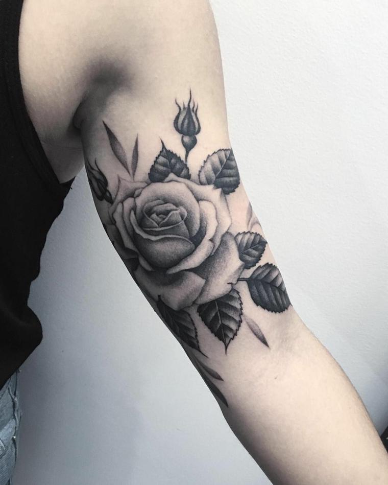 idea per un tatuaggio nella parte interna del braccio con foglie e boccioli, significato tatuaggio rosa