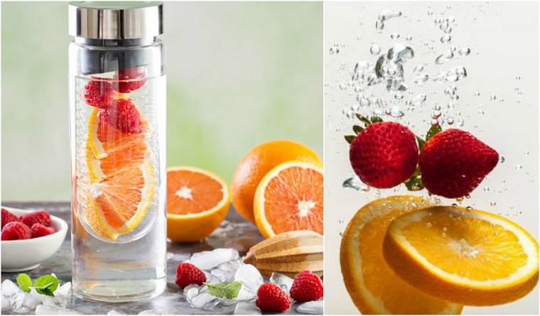 Borraccia di vetro con acqua aromatizzata ai lamponi e arancia
