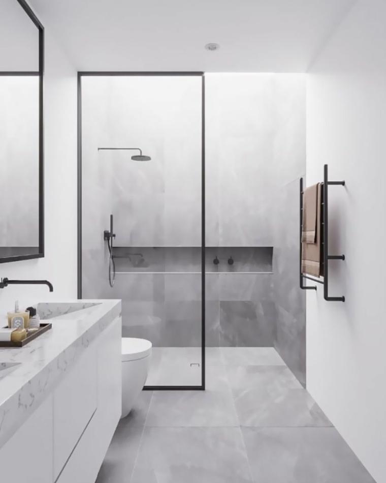 Sala da bagno con box doccia in vetro, mobile bagno con lavabo in marmo