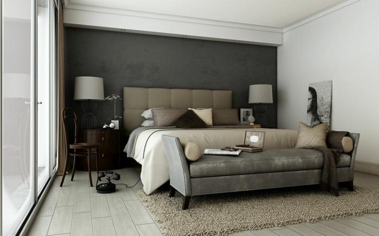 camera da letto con parete dipinta di tortora scuro pavimento in laminato chiaro con tappeto