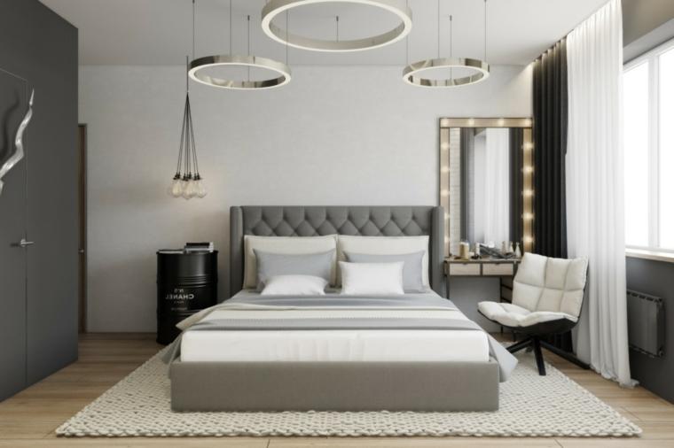 camera da letto con set di lampadari anelli pareti grigio tortora pavimento in laminato con tappeto