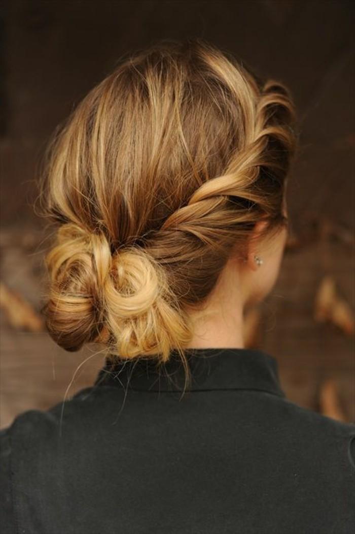 ragazza con i capelli raccolti in un morbido chignon con trecce laterali, idea per acconciature facili
