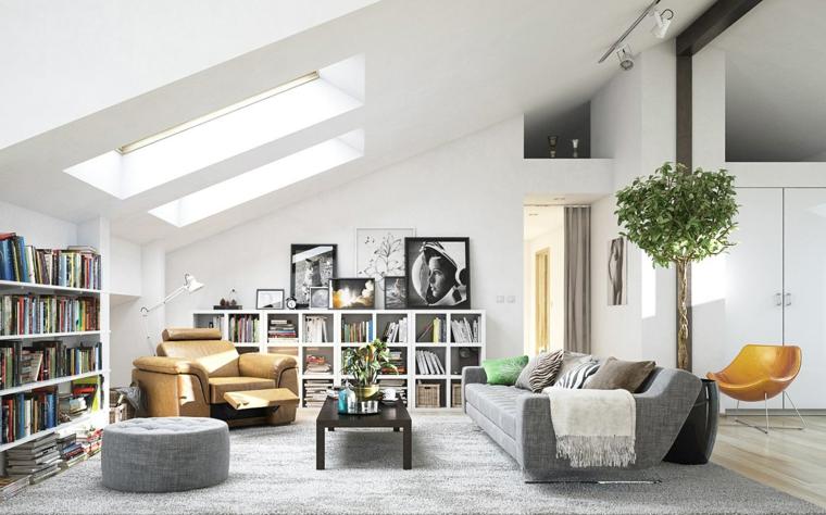 libreria su due pareti, quadri in bianco e nero, divano grigio e poltrona ocra, soluzione per arredare mansarda