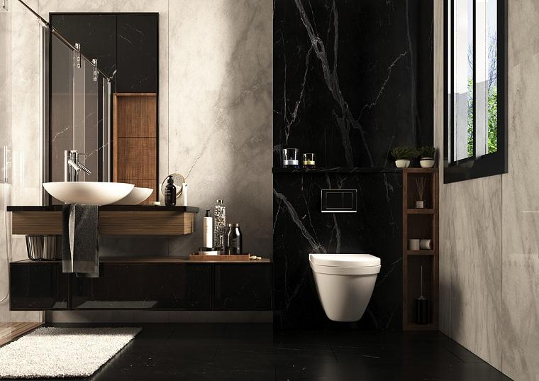 Bagni moderni, rivestimento pareti bagno con marmo nero, mobile lavabo con lavandino da appoggio