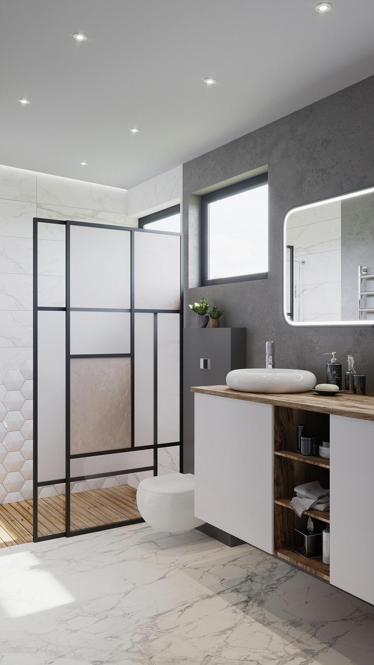 Bagni moderni con doccia, mobile in legno con lavabo da appoggio