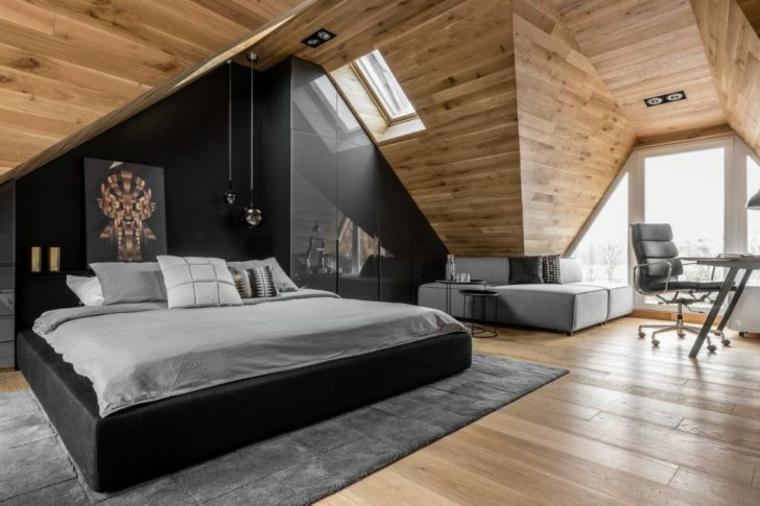 moderna mansarda arredata con letto dalla struttura nera, parete nera, tappeto grigio