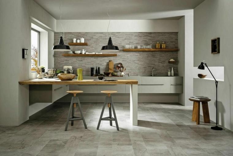 cucina color tortora pavimento in piastrelle grigie isola centrale come tavolo da pranzo
