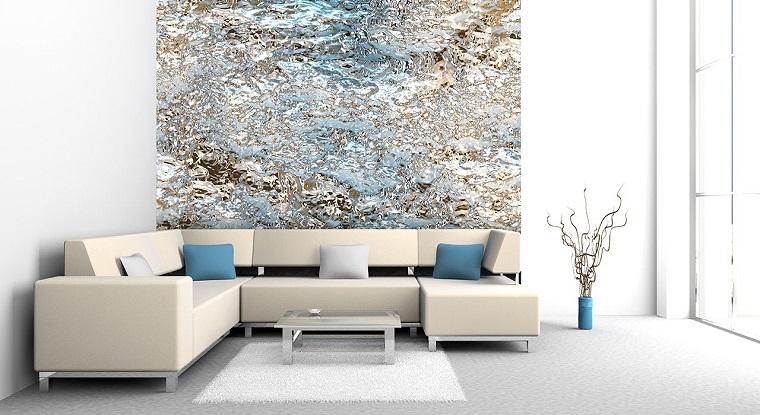 Arredare il soggiorno con un divano di colore beige angolare con penisola e tavolino basso