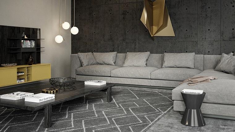 Arredare soggiorno con un divano di colore grigio e un tavolino basso di legno