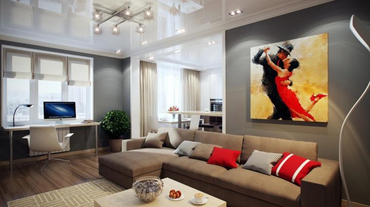 soggiorno ampio e moderno con zona studio, divano e pareti color tortora, quadro con ballerini colorati