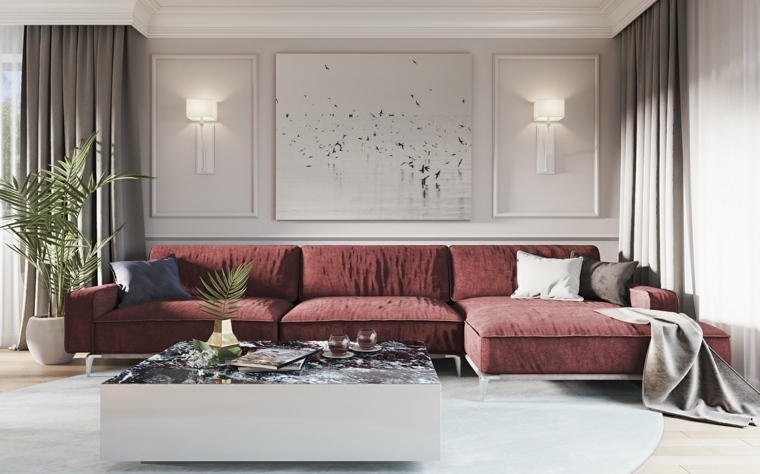 Quadri moderni per arredamento soggiorno in abbinamento ad un divano di colore bordeaux