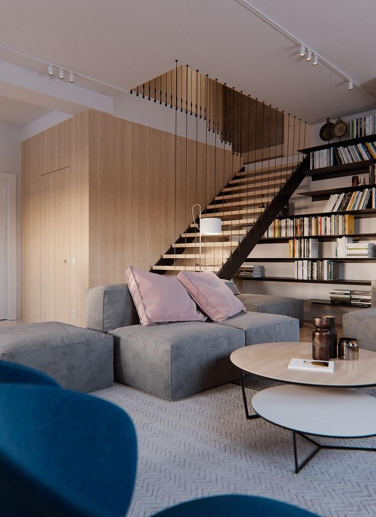 Salotto con divano componibile di colore grigio e tavolino di legno, scale moderne di design