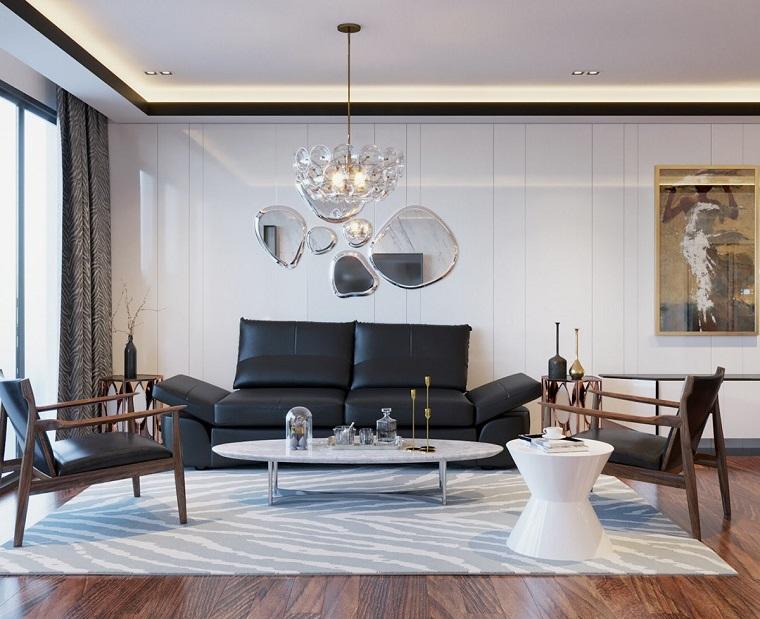 Arredare soggiorno con un divano a due posti in pelle nera e tavolino basso bianco