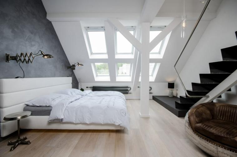 moderna camera con letto dalla struttura e testata bianca, parete grigia scura con lampada telescopica per arredare mansarda mderna