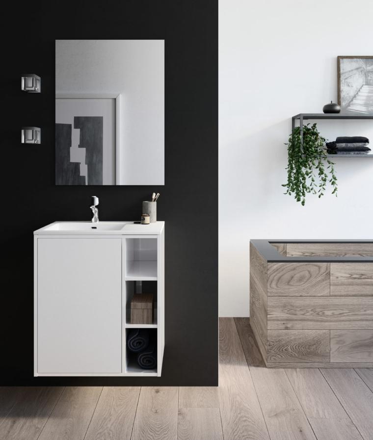 Bagni piccolo e un'idea di arredamento con mobile lavabo bianco con piccoli scomparti a vista