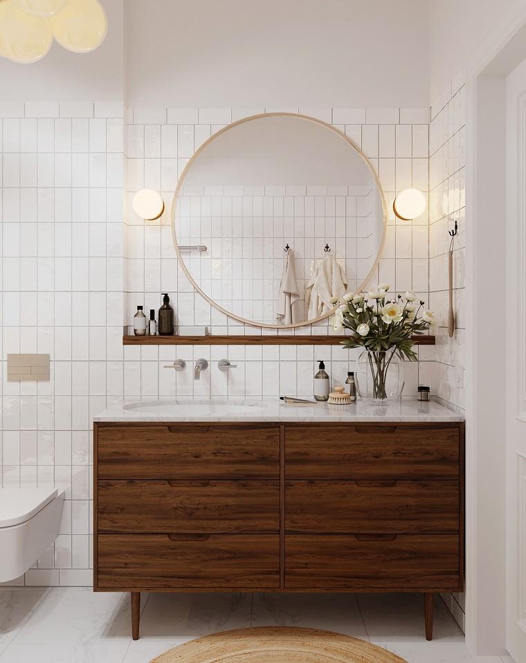Bagni moderni con doccia, mobile di legno con lavabo da incasso, parete con piastrelle bianche